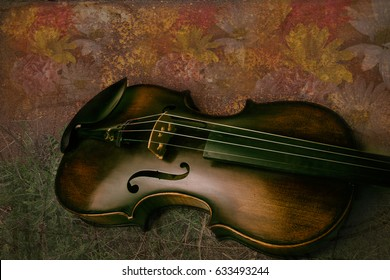 Vintage deep brown violin on a textured floral background screensaver