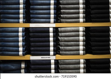 Vintage Denim jeans stack on shelves  collection in store