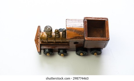 Vintage design wooden train. Isolated on white background. Slightly de-focused and close-up shot. Copy space.