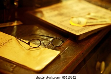 Vintage Desk - Old Wood Desk with Books and Glasses. Antique Photo Collection.