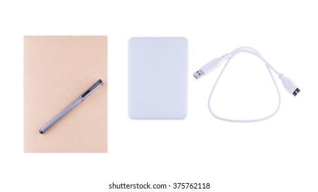 Vintage diary book and white external hard disk on white background, for writing,reading and education concept