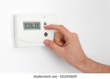 Vintage digital thermostat - Cold - Man adjusting the temperature
