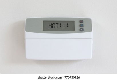 Vintage digital thermostat hanging on a white wall - Covert in dust - Hot
