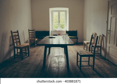 Vintage dining room with wooden floor and chairs
