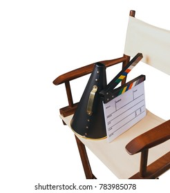 Vintage director chair with megaphone and movie clapper isolated on white