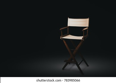 Vintage director chair on a black background
