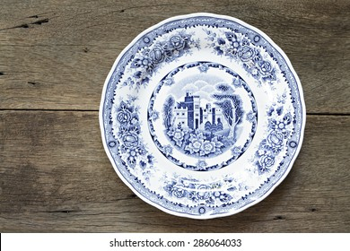 Vintage dish on wooden background