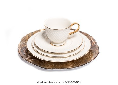 Vintage dishes and a cup isolated on white background