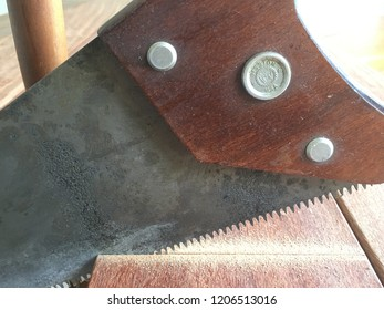 Vintage Disston crosscut saw cutting sapele in workshop. October 11, 2018. Palmetto Bay, Florida