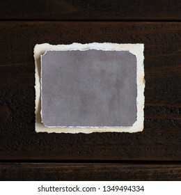 Vintage distressed and textured paper that is blank for your words, copy, text or design ideas.  Horizontal with shadow on short side.