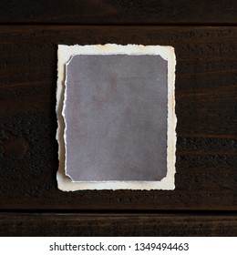 Vintage distressed and textured paper that is blank for your words, copy, text or design ideas.  Vertical with shadow on long side.