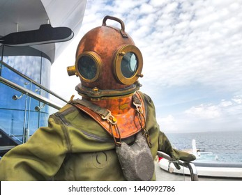 Vintage diving metal helmet and suit