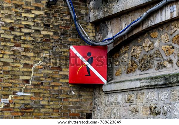 Vintage do not pee/piss/urinate sign along Seine River, Paris France.