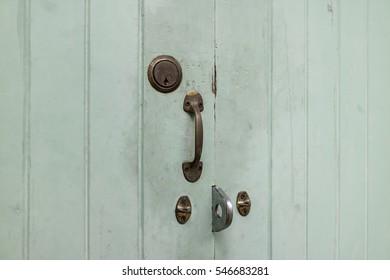 vintage door with brass handle and lock