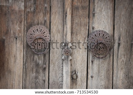 The Vintage Door Knocker Ring On A Wooden Door With Patina, Ottoman Style.  Sarajevo