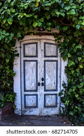 Vintage door surrounded by plants, Carmel-by-the-sea, California USA