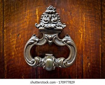 Vintage doorknob. Medieval door.