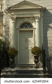 A vintage doorway with an arched window above the door of an historic home in an historic district of Charleston, South Carolina, USA.