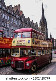 Vintage double decker tour bus in the old town of Edinburgh, Scotland, United Kingdom, May 2014,