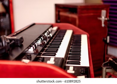 A vintage double manual organ with draw bars and rotating speaker