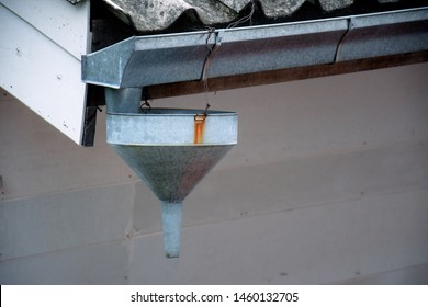 A Vintage downspout, waterspout, downpipe, drain spout, roof drain pipe leader is a pipe for carrying rainwater from a rain gutter. For accumulation and storage of rainwater for reuse on-site.