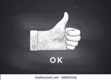 Vintage drawing of hand sign giving ok or thumbs up in engraving retro style, drawing on chalkboard with text OK. Old drawn thumbs up for sign, information sign and navigation. Illustration