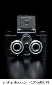 Vintage dusty camera in dark environment