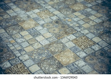 Vintage dutch tile texture, stone dark tones dalle, old retro glazed tile on floor, Mediterranean style interior concept.