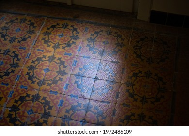 Vintage earthenware floor tiles from 20s, abstract background, graphic design. Surface frayed over years, concept of ruthless time