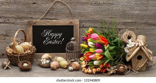 vintage easter decoration with eggs and tulip flowers. chalkboard with sample text Happy Easter!