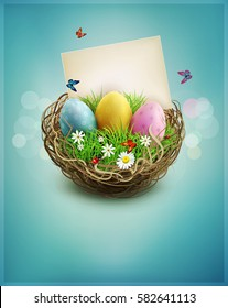 vintage Easter eggs in a wicker nest, green grass and rectangular greeting card on a blue background.