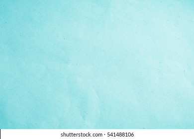 Vintage Eco flat paper bag pale texture in blue light color on table background. Organic soft turquoise plain craft book in back side concept for scrap simplicity kraft design, simple surface pattern.