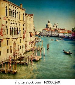 Vintage edited image from the Grand Canal of Venice with the famous landmark cathedral Santa Maria della Salute at the background