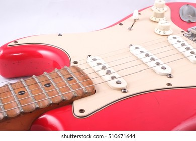 The vintage electric guitar close up.