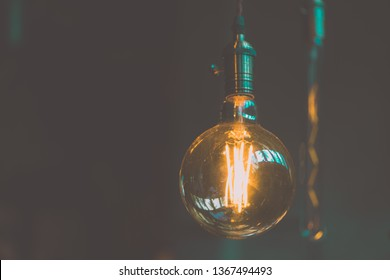 Vintage electric light.Decorative antique edison style light bulbs in coffee shop.vintage tone