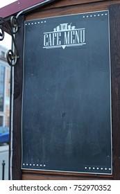 Vintage empty chalkboard menu close up outside