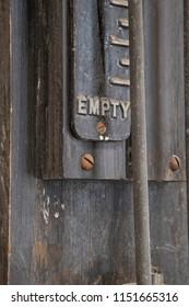 "Vintage ""Empty"" gas meter on concrete column"