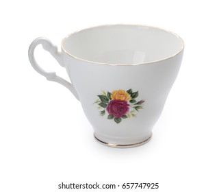 Vintage English porcelain tea cup with nice roses pattern isolated on white background