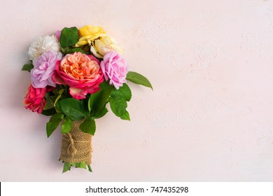 vintage english roses bouquet isolated on pink wood background  with copy space for woman valentine birthday or mother's day