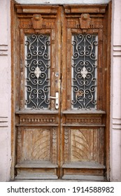 vintage entrance wooden brown door with glass.