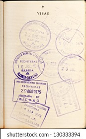 Vintage entry visa stamps to Spain in a passport.