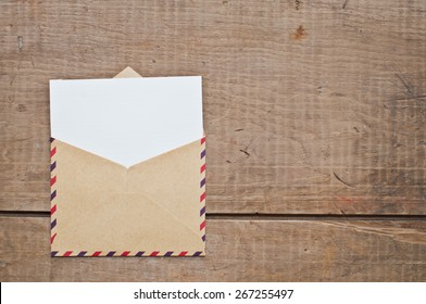 vintage envelope and card on wooden background