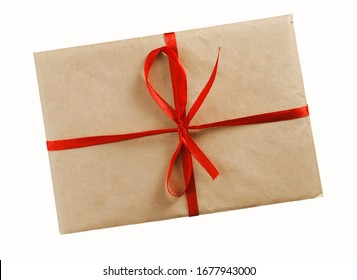 vintage envelope of kraft paper with red ribbon on white background with clipping path