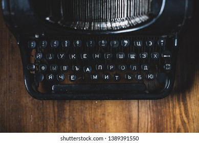 Vintage equipment journalist, publicist, writer. Antique typewriter on wooden table above view. Vintage things writer. Rare objects