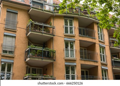 Vintage European Apartment Building Facade Balconies Front View from Street
