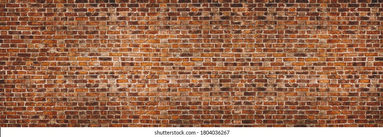 Vintage exposed brown and red old brick wall. Brickwork textured background and long brown banner.