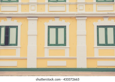 The vintage exterior design in European style of yellow building made with vintage filter.