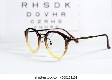 Vintage eye glasses with eye chart isolated on white