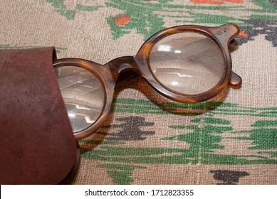 Vintage eyeglasses. Old fashioned unisex eyeglasses. Stylish antique object.