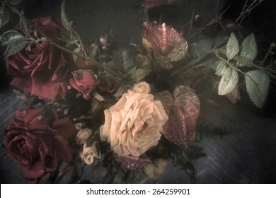 Vintage fabric bouquet of roses background, flowers stylized and filtered to look like an old painting